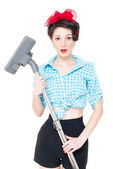 Beautiful young house wife with vacuum cleaner on white — Stock Photo