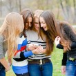Group Of Teenage Students outdoors Using Mobile Phone — Stock Photo