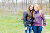 Two Teen Girl Friends Laughing in spring or autumn outdoors — Stock Photo
