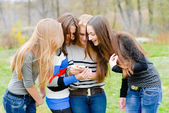 Group Of Teenage Students outdoors Using Mobile Phone — Стоковое фото