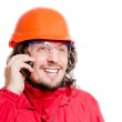 Man architector or builder speaking on mobile over white background — Stock Photo
