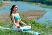 Young beautiful woman doing yoga meditation in summer outdoors — Stock Photo