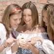 Mobile World & three happy smiling teen girls in summer outdoors — Stock Photo