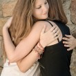 Young Girls Hug — Stock Photo #26033439
