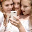 Mobile World & two happy smiling teen girls in summer outdoors — Stock Photo #26033557