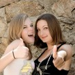 Two teenage girls showing thumbs up — Stock Photo