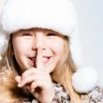 Happy little girl secrets — Stock Photo