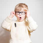 Wow: Little boy in eye glasses looking amazed — Stock Photo