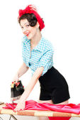 Funny pinup woman holding iron — Stock Photo