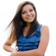 Happy young confident woman in blue blouse smiling — Stock Photo #26964567