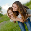 Two Teen Girl Friends Laughing  in spring or summer outdoors — Stok fotoğraf