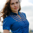 Happy young confident woman in blue blouse smiling — Stock Photo #26964865