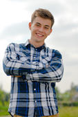 Happy young man smiling outdoors — Stock Photo
