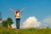 Happy teenage girl jumping on the summer outdoors background — Stock Photo