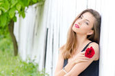 Beautiful young woman and red rose — Stock Photo