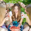 Four happy teenagers and strawberry — Stock Photo