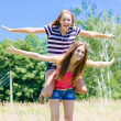 Stock Photo: Two teenage girl friends having fun outdoors on summer day