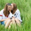 Two teen girl friends sharing secret — Stock Photo