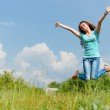 Happy teenage girl jumping on the summer outdoors background — Stock Photo #28383475