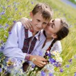 Teenage sister and little brother together on summer wheat fields — Stock Photo #28386517