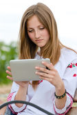 Happy smiling teen girl and tablet computer — Stock Photo