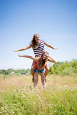 Two teenage girl friends having fun outdoors on summer day — Stock Photo