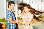 Young happy couple dancing on street — Stock Photo