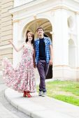 Young happy couple walking in city — Stock Photo