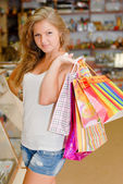 Happy young woman with shopping bags — Stok fotoğraf