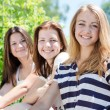 Three happy teen girl friends looking together in one direction — Stock Photo #31204209