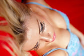 Beautiful lying girl face and long eyelashes — Stock Photo