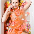 Beautiful sexy young woman in bath with flower petals — Stock Photo