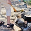 Saucepan hanging over the fire on rocks at seacoast tourist camp — Stock Photo