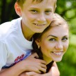 Stock Photo: Teenage sisrer and little brother hugging