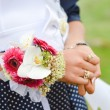 maid of honor holding flower bouquet — Stock Photo