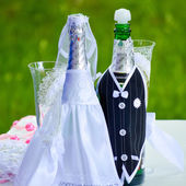 Wedding ceremony details decorated bottles — Stock Photo