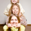 Three happy brother and sisters hug — Stock Photo