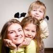 Three happy brother and sisters hug — Stock Photo #34885299