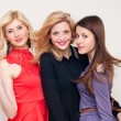 Three happy beautiful fashion women studio shot — Stock Photo