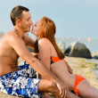 Stock Photo: Young happy couple mand womlying on sandy beach