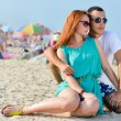 Young happy couple together on sandy beach embracing — Stock Photo