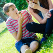 Happy teen couple eating ice cream on sunny summer day — Stock Photo