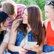 Stock Photo: Four happy teen friends laughing on picture of themselves