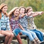 Girls on river bridge — Stock Photo