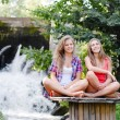 Two teen girls sitting in yoga position — Stock Photo