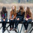 Girls on river bridge — Stock Photo