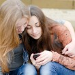 Stock Photo: Teenage girls with mobile