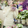 Womin flower shop — Stock Photo #37103173