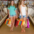Two happy young women with shopping bags — Stock Photo #37104339