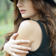 Portrait of beautiful young woman with hat — Stock Photo #37104583